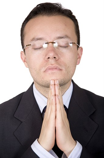 business man praying over a white background : Stock Photo