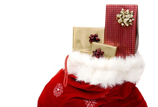 Stock Photo: 1525R-113865 sack full of gifts over a white background