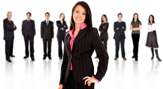 business team with a businesswoman leading it - isolated over a white background : Stock Photo