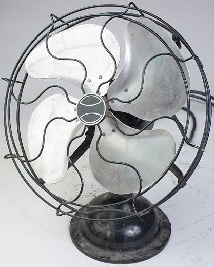 Antique metal fan : Stock Photo