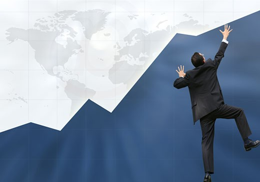 business graph with business man climbing it up : Stock Photo