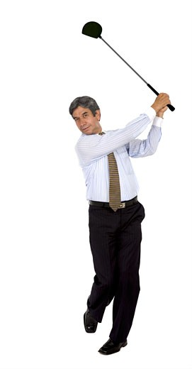 Stock Photo: 1525R-114918 Business man swinging a golf club isolated over a white background