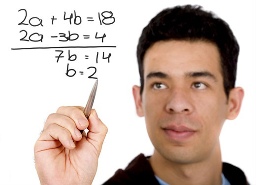 Stock Photo: 1525R-115048 mathematics student solving a problem on the screen - isolated over a white background
