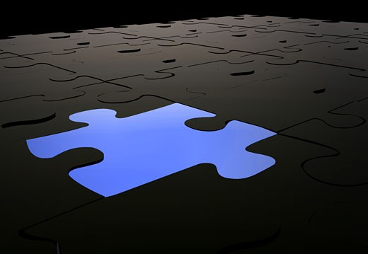 blue puzzle piece amongst black pieces in 3d : Stock Photo