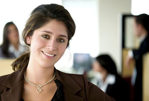 Stock Photo: 1525R-115203 business woman portrait leading her team in an office environment