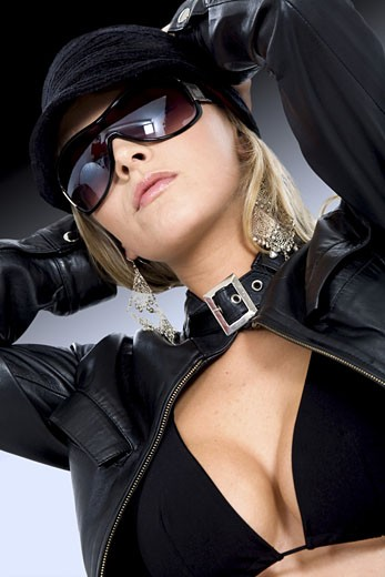 Stock Photo: 1525R-115317 fashion model portrait wearing sunglasses over a dark background