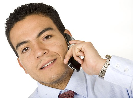 Stock Photo: 1525R-115733 Business man on the phone smiling - isolated over a white background