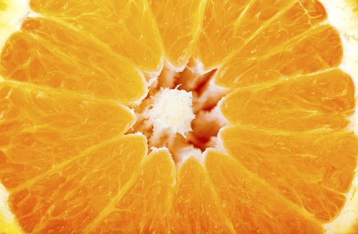 Stock Photo: 1525R-116128 delicious orange close up showing the texture - background