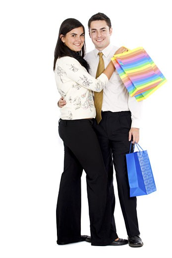 Stock Photo: 1525R-116204 couple doing shopping with bags isolated over a white background