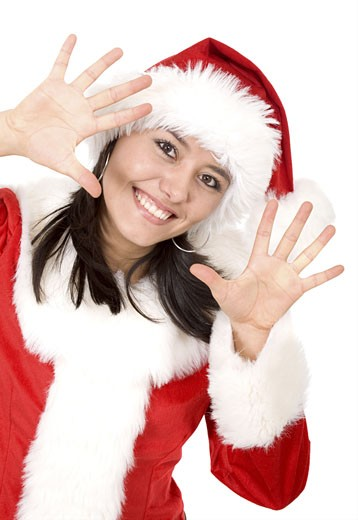 Stock Photo: 1525R-116394 christmas female santa appearing in the frame looking happy with her hands next to her face - isolated over a white background