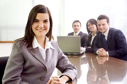Stock Photo: 1525R-116567 business team with a businesswoman leading it in a corporate environment