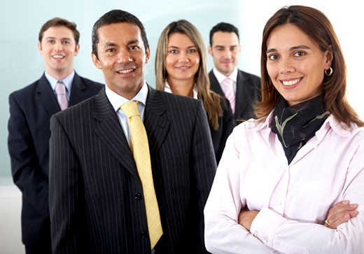 Business team in an office with a businesswoman leading : Stock Photo