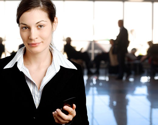 Stock Photo: 1525R-118004 Succeful young businesswoman is posing in the lobby.