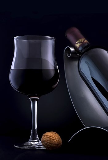 Stock Photo: 1525R-118019 A glass of an elegant, quality red wine.