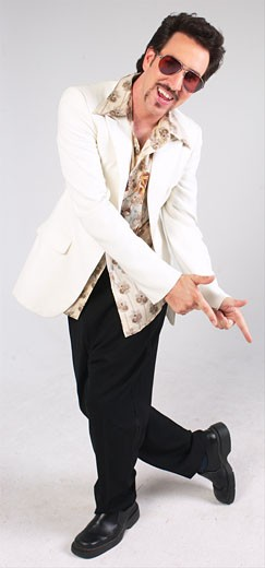 Stock Photo: 1525R-12121 Man dancing in seventies-style clothes 2