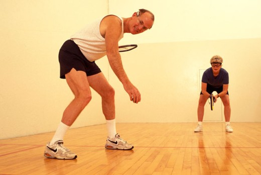 Stock Photo: 1525R-12376 Elderly Couple Playing Racquetball
