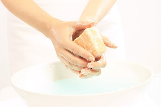 Stock Photo: 1525R-12515 Person washing their hands with bar of soap 3