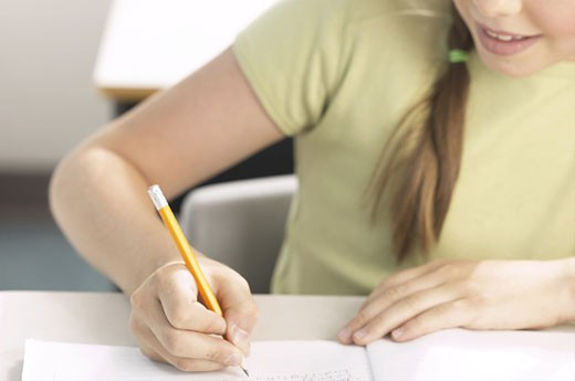 Stock Photo: 1525R-12894 Little girl writing at her desk 8