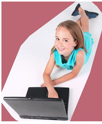 Little girl using laptop  : Stock Photo