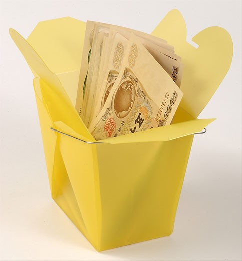 Money in take-out box  : Stock Photo