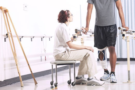 Physical therapist with patient  : Stock Photo