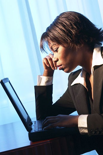 Woman using laptop an 1 : Stock Photo