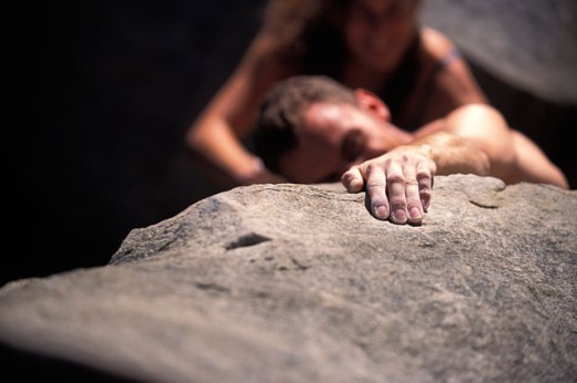 Rock Climber Reaching : Stock Photo