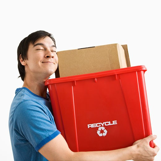 Portrait of smiling Asian young man holding recycling bin. : Stock Photo