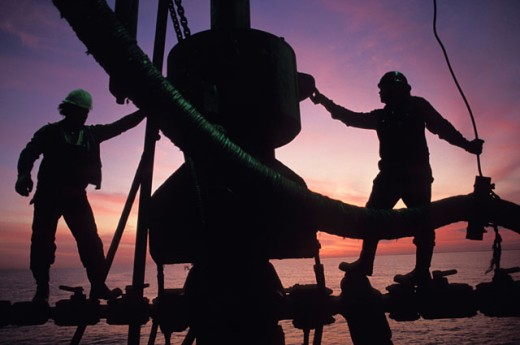 Industrial Workers on an Oil Rig : Stock Photo