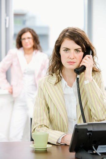 Business woman calling on phone : Stock Photo