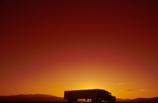 Truck Driving at Sunset : Stock Photo
