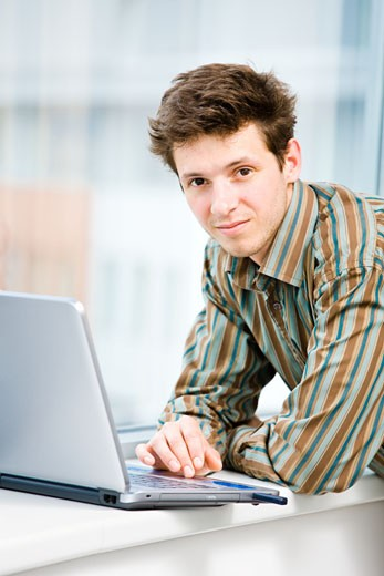 Stock Photo: 1525R-153209 Businessman with laptop computer