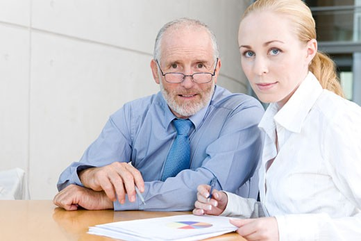 Stock Photo: 1525R-155490 older businessman with female assistant