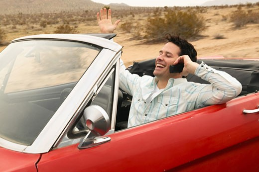 Smiling male young adult driving car  : Stock Photo
