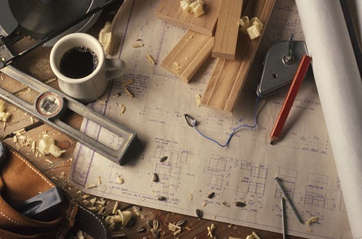 A carpenters tools and drawn out plans : Stock Photo