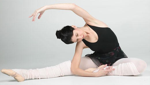 Stock Photo: 1525R-16540 Ballerina stretched on the floor