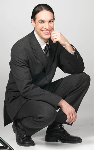Stock Photo: 1525R-16639 Kneeling and smiling businessman