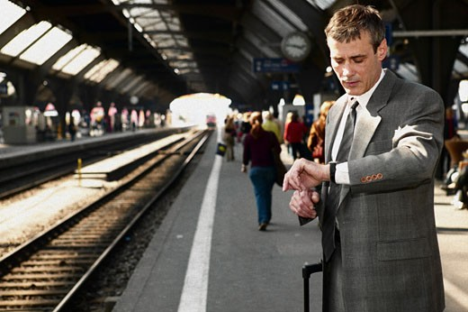Stock Photo: 1525R-16982 Businessman waiting for train