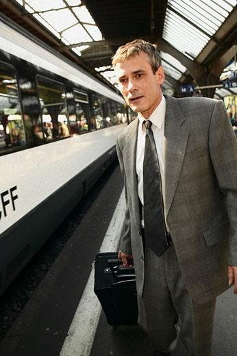 Man boarding train  : Stock Photo