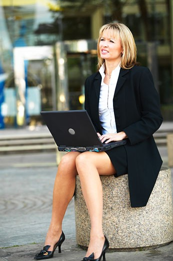 Businesswoman using laptop computer  : Stock Photo