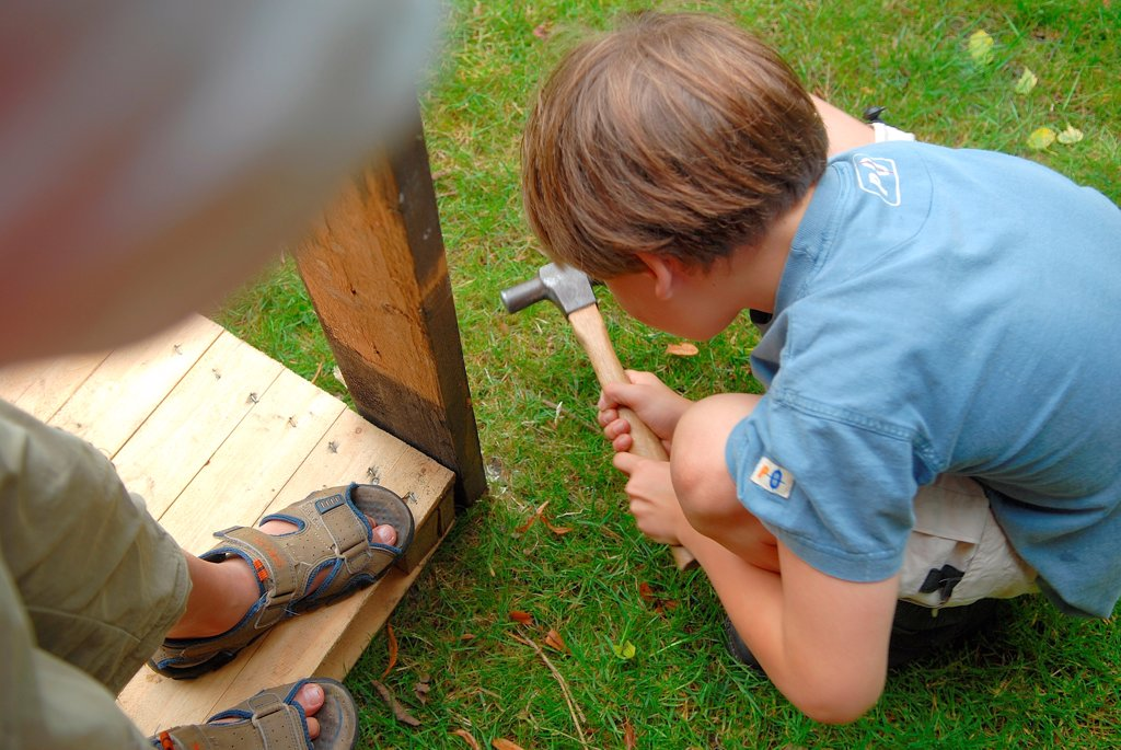 Young boys building in the garden : Stock Photo