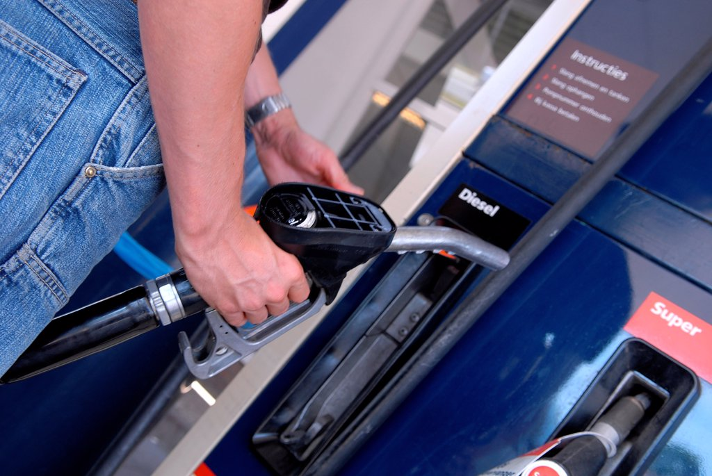 Stock Photo: 1525R-191838 Man refuelling petrol at gas station