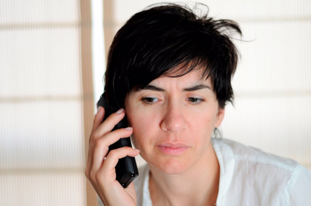 Woman talking on phone : Stock Photo