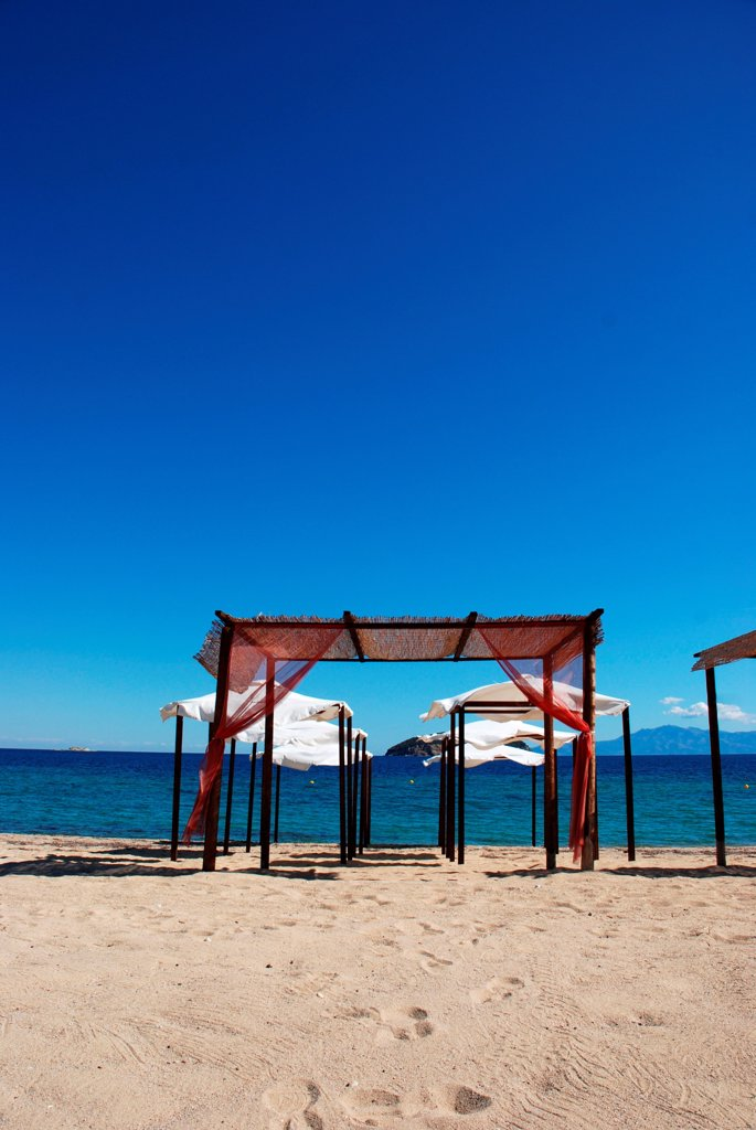 Stock Photo: 1525R-192132 Summery shaded resting areas on beach, Greece