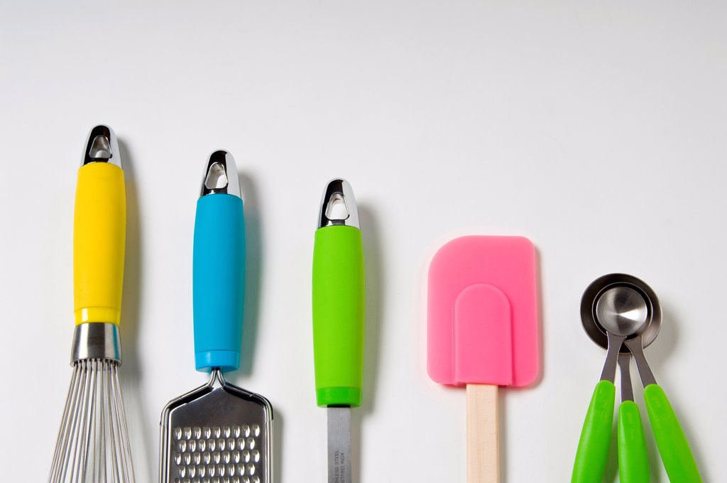 Stock Photo: 1525R-192743 Kitchen utensils with neon accents on a white background.