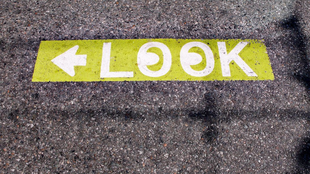 Caution to look both ways street pavement sign. : Stock Photo