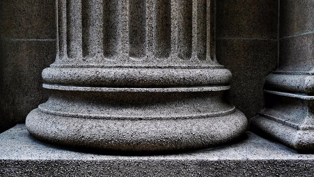 Close-up of a strong supportive pillar base. : Stock Photo