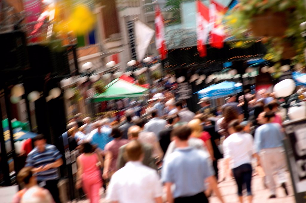 Stock Photo: 1525R-193678 Crowded downtown sidewalk in the summer.
