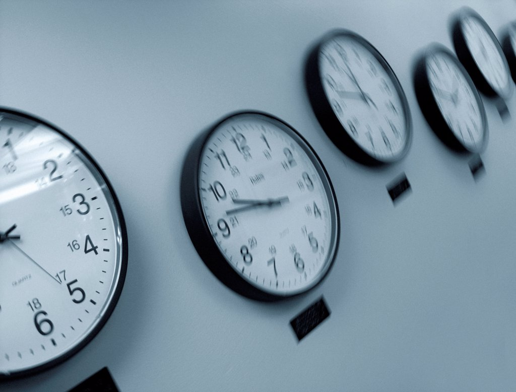 Stock Photo: 1525R-194444 Row of clocks displaying different time zones.