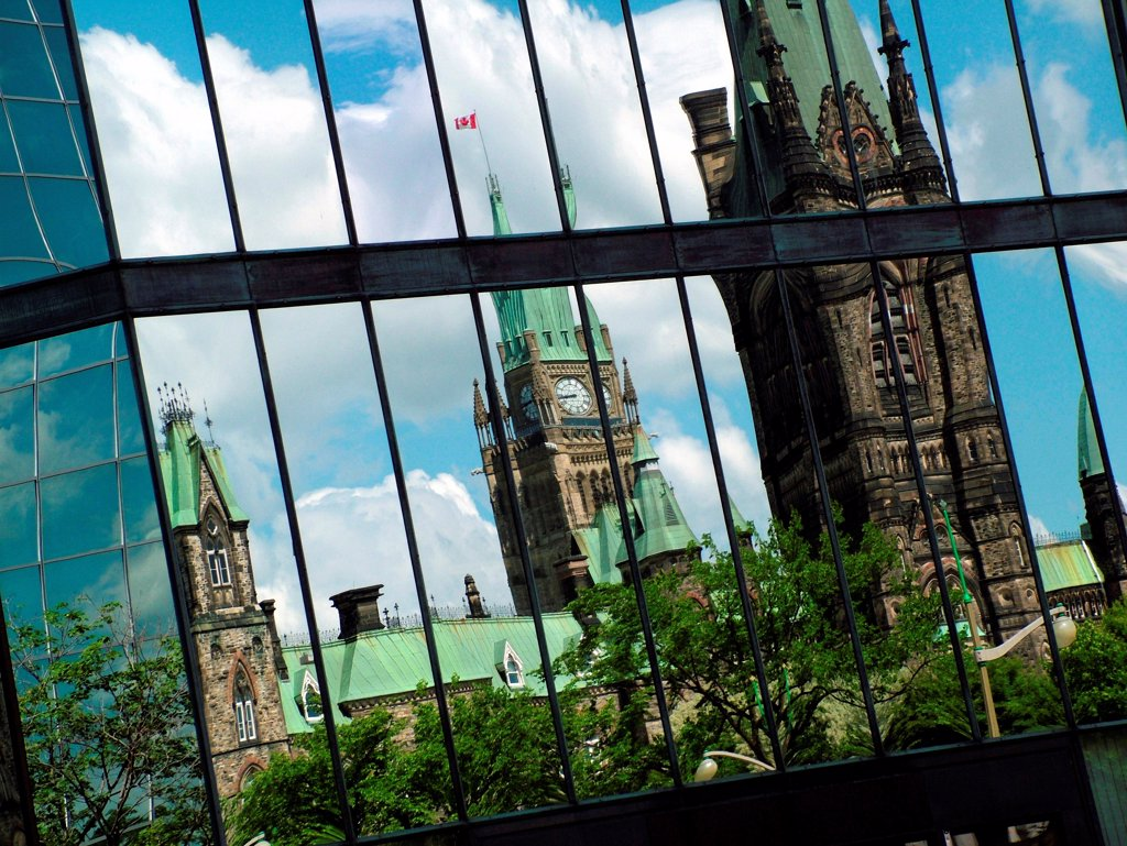 Stock Photo: 1525R-194746 Ottawa Parliament Buildings reflecting in glass.